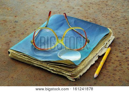 Old Notebook, Pencil And Glasses