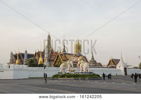 BANGKOK THAILAND - NOV 22 : morning scene of mourners on Ratchadamnoen Nai road near wat phra kaew while the funeral of king Bhumibol Adulyadej in Grand Palace on november 22 2016