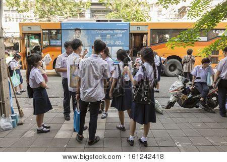 BANGKOK THAILAND - NOV 22 : unidentified people at bus stop in Pak Khlong Talat on november 22 2016 thailand. Pak Khlong Talat or flower market is biggest wholesale fresh flower of Bangkok