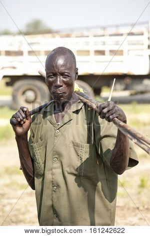 BOR, SOUTH SUDAN-DECEMBER 4, 2010: Portrait of an unidentified Dinka man in a remote area north of Bor, South Sudan
