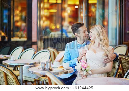 Just Married Couple In Traditional Parisian Cafe