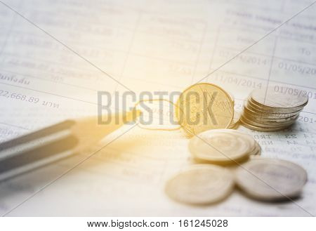 Double exposure stack of coins and utility bill with account banking for finance Money and finance concept
