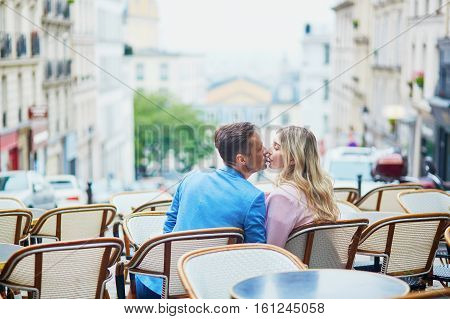 Couple In Outdoor Cafe On Montmartre, Paris, France