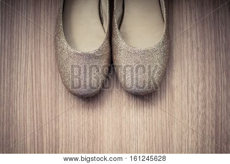 Women's shoes old on a wood background