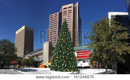 PHOENIX AZ - NOVEMBER 17 2016: White reflective tarp covering downtown city skating ring with decorated Christmas tree in sunny Phoenix Arizona