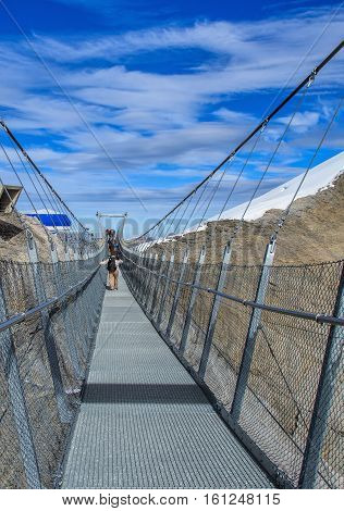 Mt. Titlis, Switzerland - 12 October, 2015: the Titlis Cliff Walk suspension bridge. The Titlis Cliff Walk is a pedestrian suspension bridge along the cliff of Mount Titlis in the Swiss Alps.