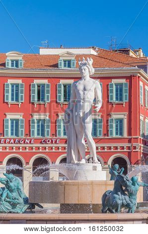 Nice France - April 19 2016: Famous fountain du Soleil with the statue of Apollo by Alfred Auguste on Place Massena in Nice on the French Riviera.