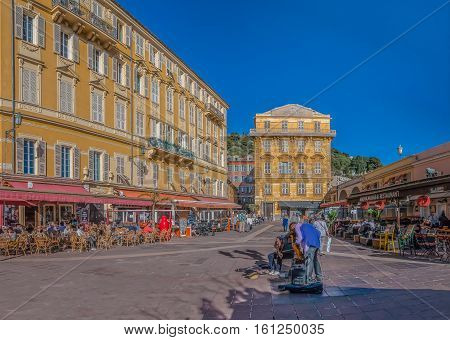 Nice France - April 20 2016: Musicians playing by the street cafes in the Old Town Vieille Ville of Nice