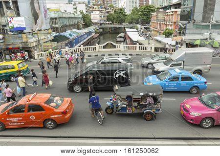 BANGKOK THAILAND - JUL 27 : people across in traffic jam on Ratchadamri road in the way to Pratu Nam market near CentralWorld on july 27 2016 thailand.
