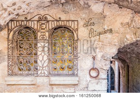 Eze, France - October, 08, 2016: Ornate metal works on the windows of old buildings in the picturesque medieval city of Eze Village in the South of France along the Mediterranean Sea