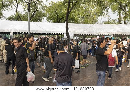 BANGKOK THAILAND - OCT 19 : people in Sanam Luang area while the royal funeral of king Bhumibol Adulyadej in Grand Palace on october 19 2016