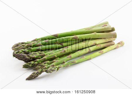 Fresh green asparagus spears on white background