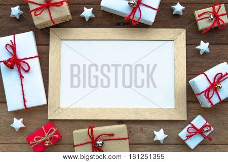 Christmas Gift Box And Whiteboard On Wood Background