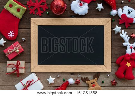 Christmas Gift Box And Blackboard On Wood Background