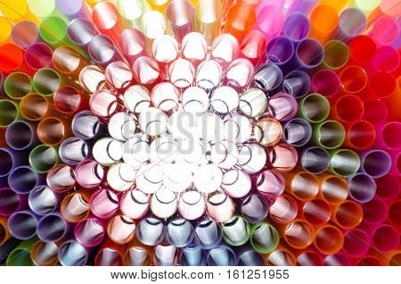 Plastic straw color. A light shone through a circular pipe. Took shape beautiful colors Take a closer focus on the details clearly.