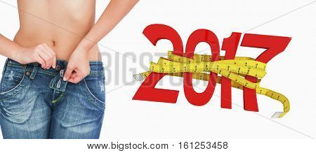 3D Midsection of slim woman buttoning jeans against digitally generated image of new year with tape measure