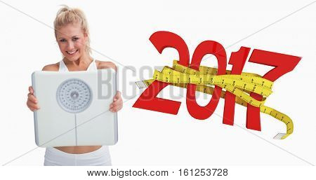 3D Portrait of young happy woman holding out weighing scales against new year with tape measure