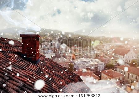3D Snow falling against city landscape