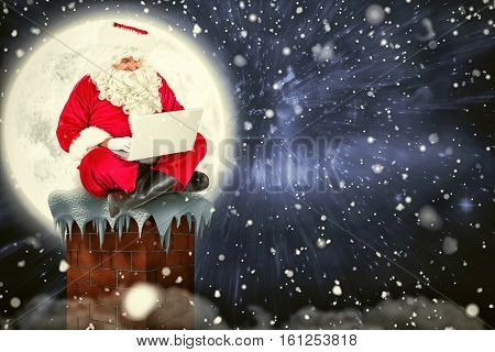 3D Santa sitting and using his laptop against composite image of full moon