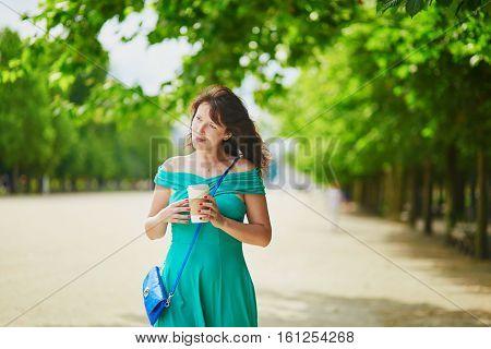 Beautiful Young Woman Walking In Parisian Tuileries Park