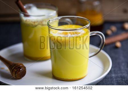 Homemade Turmeric with honey and cinnamon latte