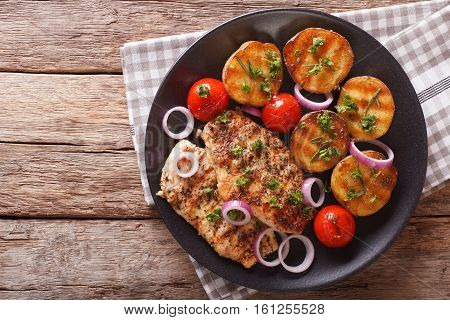 Healthy Food: Fried Chicken Breast With Grilled Potatoes And Tomatoes Macro. Horizontal Top View