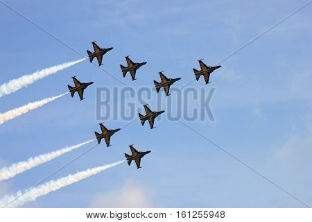 Changi, Singapore - February 13, 2014: The Korean Black Eagles aerobatics team flying in formation at the Singapore Airshow 2014.