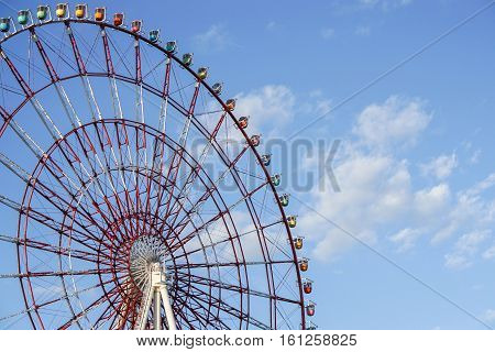 red ferris wheel with bright clear blue sky