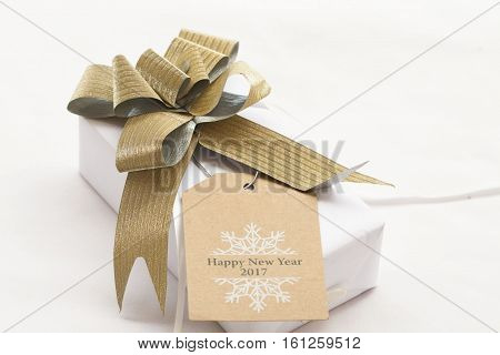 happy new year 2017 box gift and message card on background white