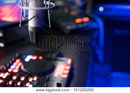 DJ mixer at a nightclub a microphone. Workplace DJ.