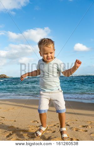 Child having fun on the beach at day time