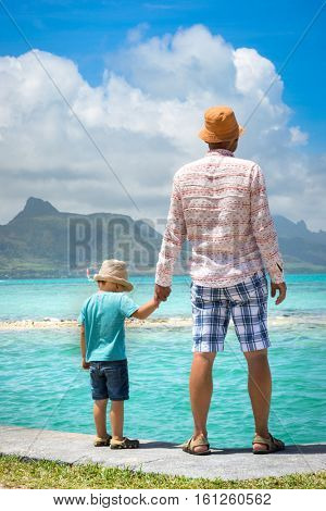 Father and son at seaside. Mauritius