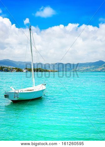 Sailboat in a sea at day time. Mauritius