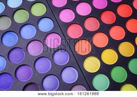 Professional colorful makeup palette close-up. Eyeshadows palette.