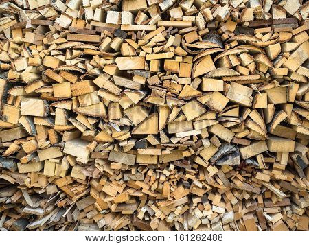 Picture of the firewood stack texture close up. Background of the firewood stack pattern close up.