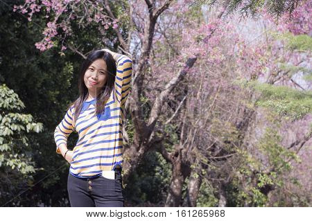Beautiful Thai woman with Wild Himalayan Cherry, portrait