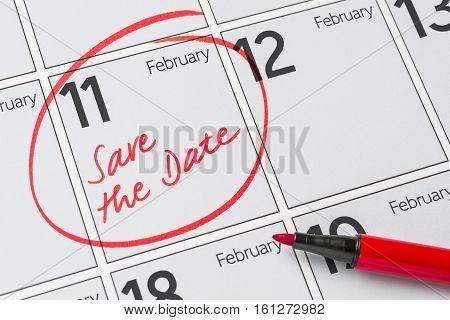 Save The Date Written On A Calendar - February 11