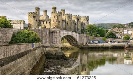 Conwy Castle is a medieval fortification in Conwy, on the north coast of Wales. It was built by Edward I, during his conquest of Wales, between 1283 and 1289.