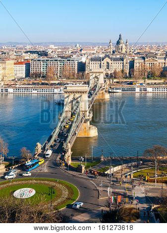 Famous Chain Bridge over Danube River and Saint Stephen's Basilica view from Buda Castle on sunny autumn day in Budapest, capital city of Hungary, Europe. UNESCO World Heritage Site