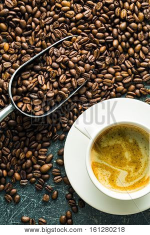 Roasted coffee beans and cup of coffee.