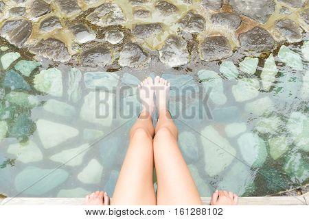 Legs inside onsen