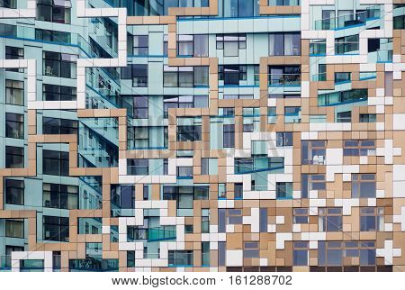 Colourful modern building in Birmingham England featuring an intricate facade and multiple windows.