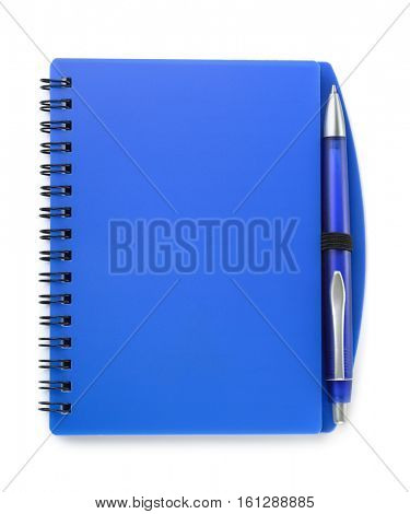 Top view of blue notebook and pen isolated on white