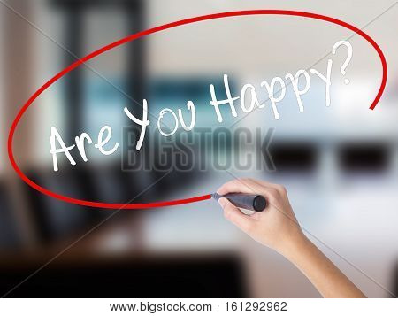 Woman Hand Writing Are You Happy? With A Marker Over Transparent Board