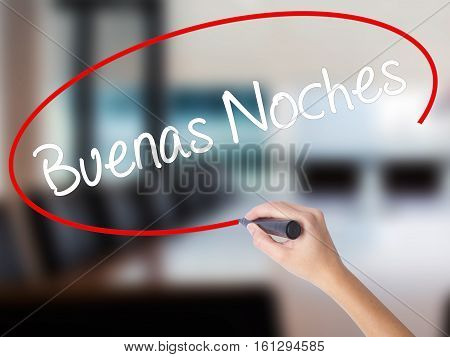 Woman Hand Writing Buenas Noches (good Night In Spanish) With A Marker Over Transparent Board.