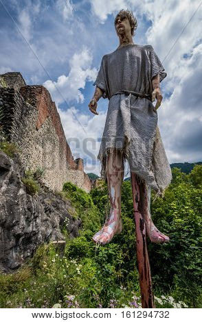 Mount Cetatea Romania - July 6 2016: Impalement scene in front of Ruined Poenari Castle on Mount Cetatea in Romania