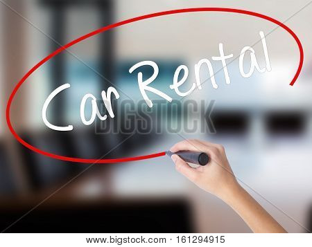 Woman Hand Writing Car Rental With A Marker Over Transparent Board
