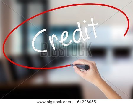 Woman Hand Writing Credit With A Marker Over Transparent Board