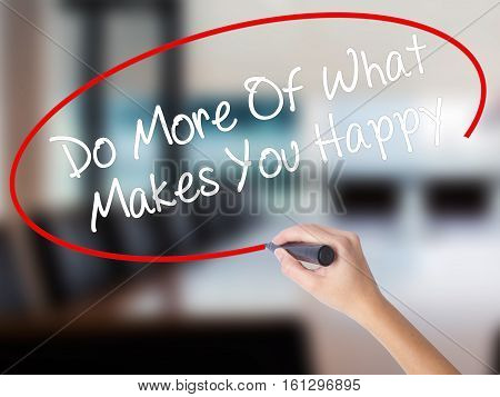 Woman Hand Writing Do More Of What Makes You Happy With A Marker Over Transparent Board