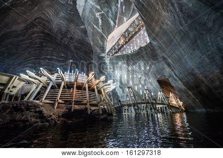 Turda Romania - July 8 2016: Underground lake in Salina Turda salt mine in Turda city